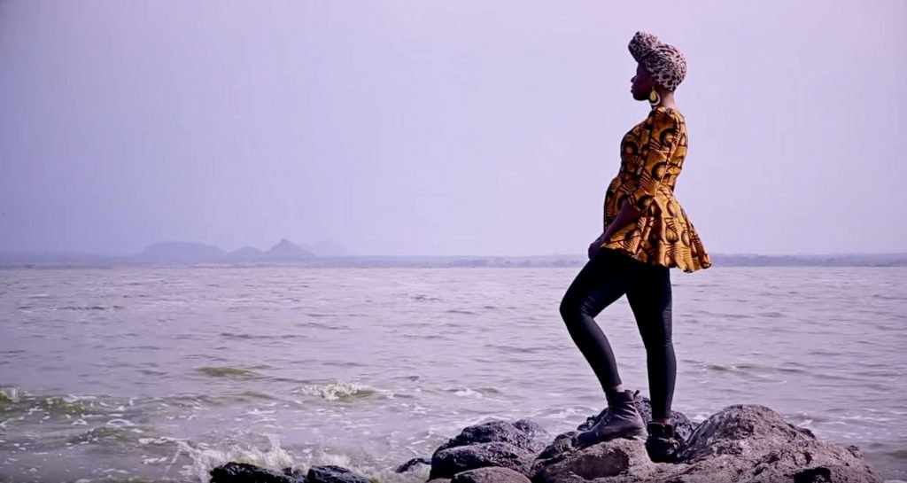 woman-stands-at-the-sea